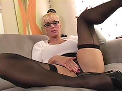 Office bimbo in sweater teases you