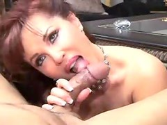 Mature in lipstick mouths a big cock