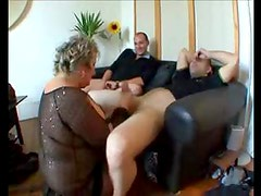 Two guys play with a fat granny