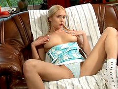 Anika the sexy blonde with pigtails drills her pussy with a dildo