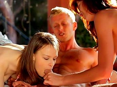 Slender Barbara Sweet and Beata are making blowjob in a hot threesome