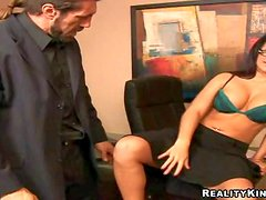 Seductive black haired tanned secretary with big firm hooters and