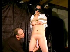 Dildo fucks pierced pussy of a tied up girl