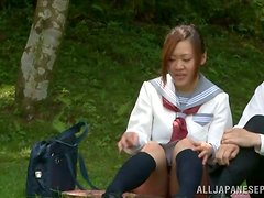 School couple are having an outdoor sex in the park