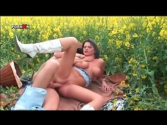 Busty girl in sexy boots boned in the ass outdoors