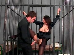 Prison sex with a busty girl in black stockings
