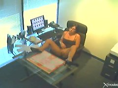 Masturbating in office on security camera