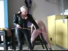 Leather mistress abusing man