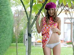 Playful Guerlain removes her white cotton panties outdoors and flashes