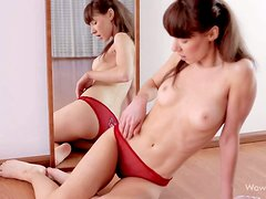 Skinny topless teen Elly in red panties and black shoes