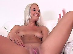 Blonde sexy bitch Evelyn fingers her tight pussy as