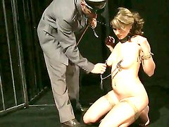 Bonded brunette Norah Swan gets her nipples clamped