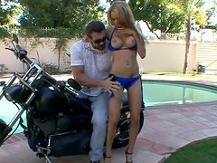 Steamy busty slut gives a head to aroused biker by the pool