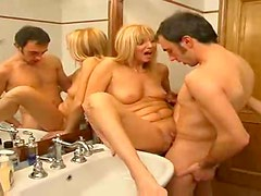 Pierced clit milf gets fucked in bathroom