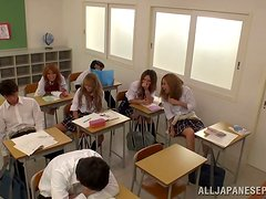 Babe gives him classmate a handjob right during the class