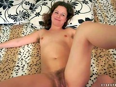 Flat chested naked brunette Hadjara with hairy snatch poses naked