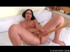 Provocative naked black haired bitch with nerdy glasses and nice