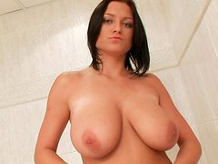 Big-ttited babe Lucy Diamonds is playing with her shaved pussy