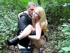 Blonde sexy angel in nature's garb in park