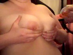 He plays with her nipples and masturbates