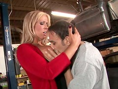 Busty blonde bombshell gives a mechanic a great blowjob