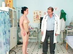 Kinky doctor drills bearded pussy of Helena with his fingers