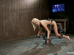 Breanne Benson gets fucked hard with a toy in a hot BDSM scene