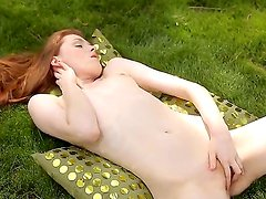 Wonderful redhead Rossy Bush is showing her sweet small boobies on tape, while
