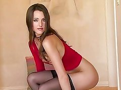 Brunette Erica Ellyson plays her wet twat wearing a sexy black stockings