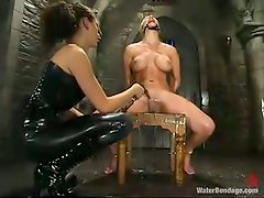 Tied up blonde gets her pussy drilled by a fucking machine