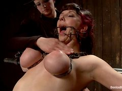 Delightful honey gets chained and toyed in her holes