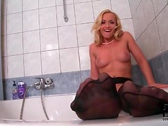Black stockings on pretty girl washing her feet