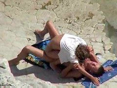 On top of his cock at the beach