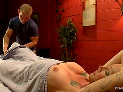 Blonde tranny Morgan Bailey seduces masseur Alex Adams and fucks him