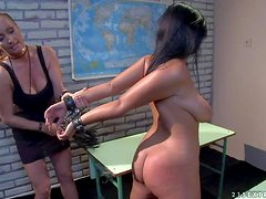 Naked handcuffed brunette Leilla with huge natural tits stands still