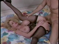 Lovely lingerie on this retro fake tits milf