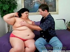 Chubby Latina brunette with tattoos sucking on a long dong