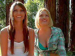 Two tied up blonde chicks get fucked in a forest
