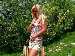 Gardening delights with a desirable blondie