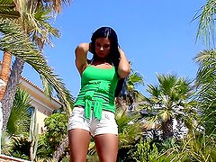 Hot brunette Ashley gets naughty in the yard in hot solo clip