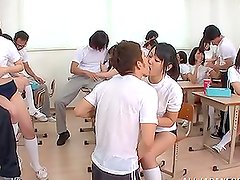 Sayaka Kazuki gets fucked during a wild orgy in a classroom