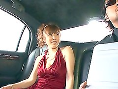 Delicious slut in a sexy dress gets fucked hard in a limo