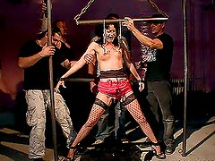 Brunette sex slave gets tied up and toyed with by a group of dudes