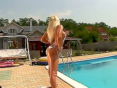 Hot Oiled Up Blonde Fucked By The Pool