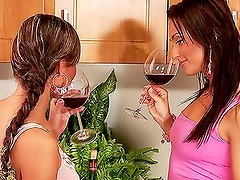 A glass of wine drives these two babes wild