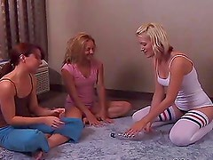 Anna Bell Lee, Kimberly Kane and Lindsey Meadows lick each other on a bed