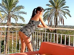 Hot brunette fingering her pussy and asshole outdoors