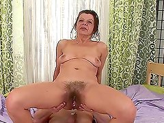 Nasty granny Ludmila fucks Steve Q and gets a creampie in her hairy cunt