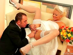 Pretty blonde bride giving her husband a blowjob