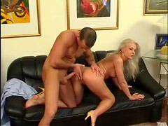 Elegant blonde with luscious long legs pumped from behind
